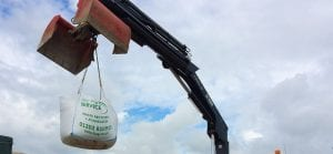 aggregate in bulk bag being lifted